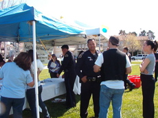 police talk to attendees